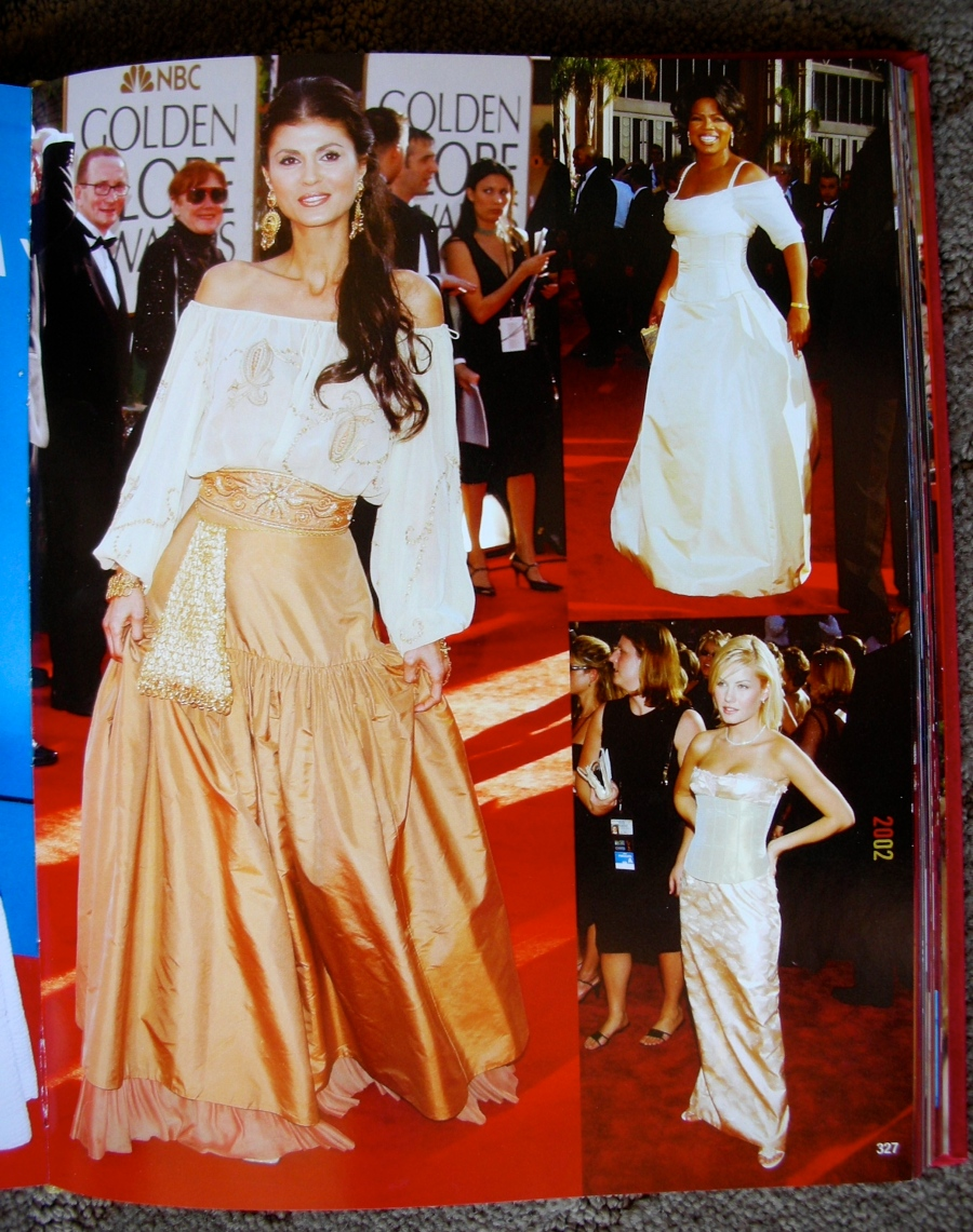 Attending the 2002 Golden Globes Awards, Mrs. Micheline Etkin poses as she arrives on the red carpet for the international press and papparazzi on a luxurious two piece ensamble (blouse & skirt) designed for the occassion by talented Fashion Designer, Mr. Michael Casey.The picture is on the RED CARPET book along with other movie stars, TV stars and personalities attending the sumptuous occassion.