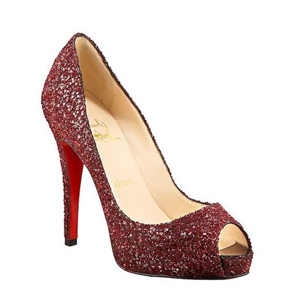 "Ms. Frye is wearing a pair of ""Christian Louboutin"" glittering platform peep toe pumps Oxblood shoes.....a trademark of her *SHOE FEVER * when she is conducting a LIVE AUCTION....!"