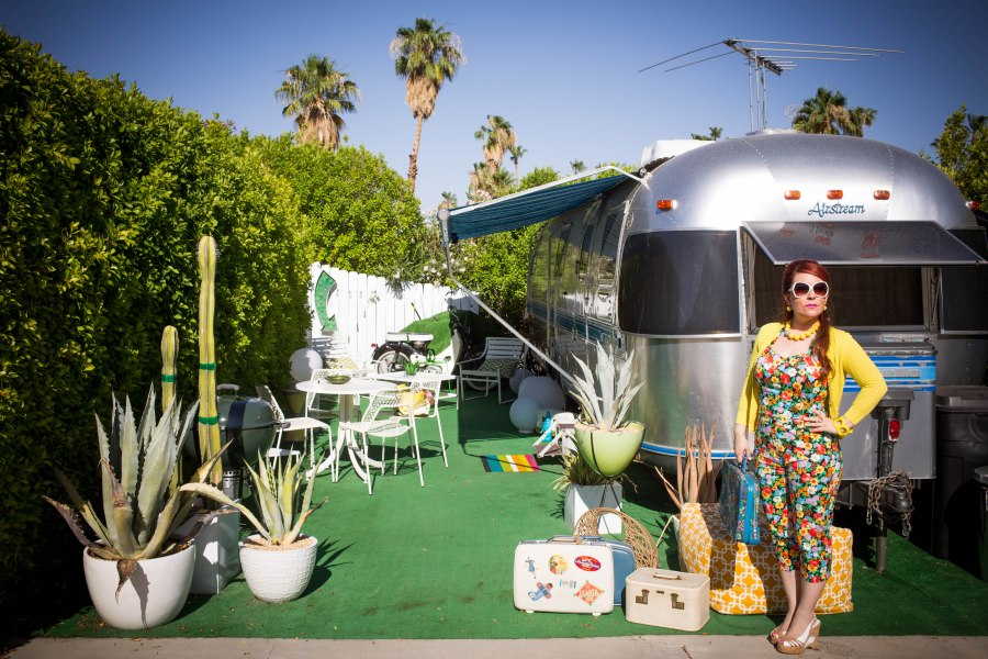 The domestic life always will be present in her trips, that is where all reside, to meet and know the locals, to find the essence of a place… Location: Palm Springs, airstream park Hair by: Read Brown Salon Makeup by: Nicole Floral corset and Capri pants by: Louise of Positano Photographer: Dre Naylor