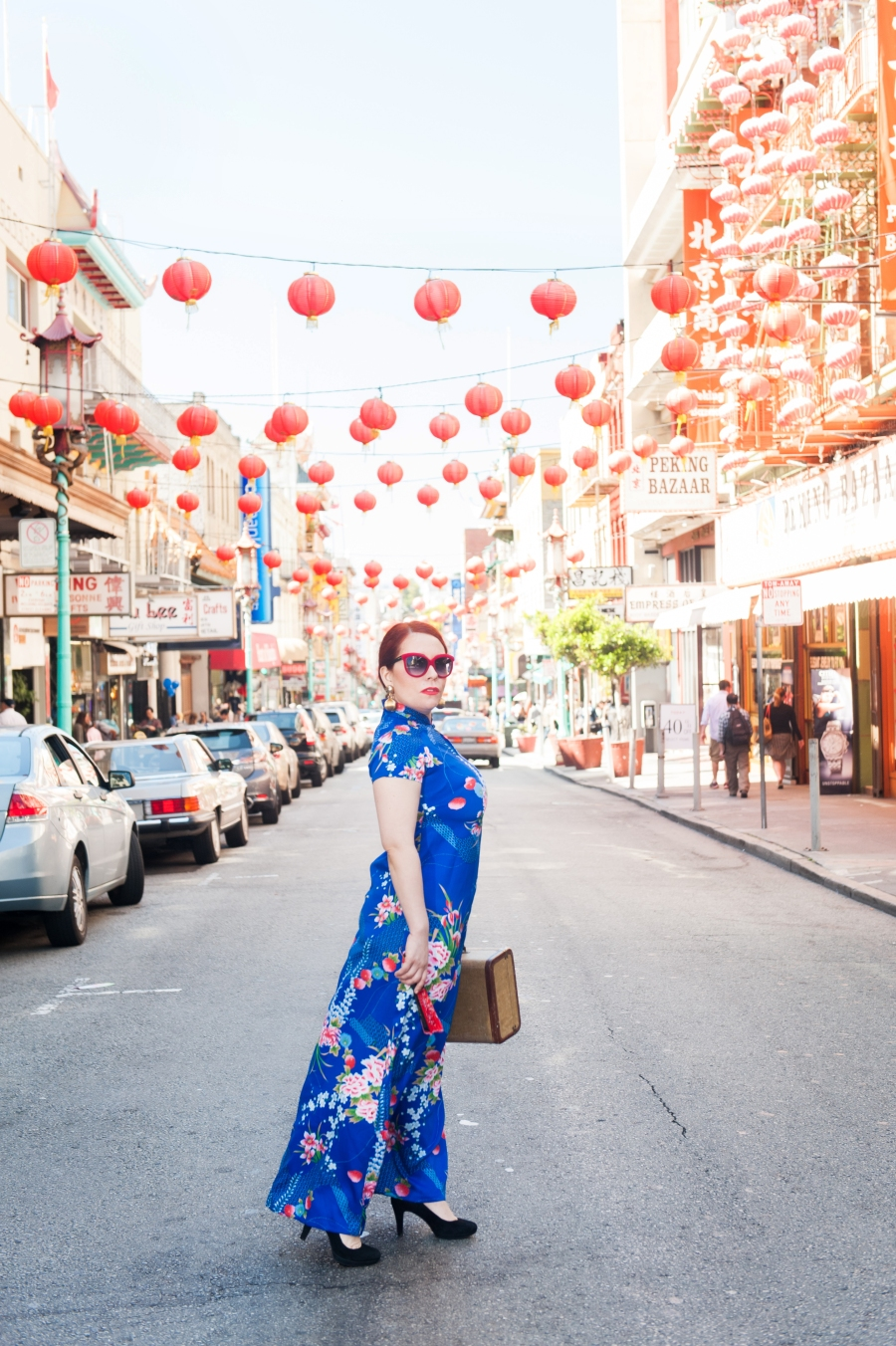 When traveling to any place, Nicole studies the locations, the styles and sense of space, and even the lighting to make sure images like this are simply timeless. Location: Chinatown, San Francisco Hair and makeup: Nicole Vintage dress: Antique Sugar Photographer: Maria Del Rio