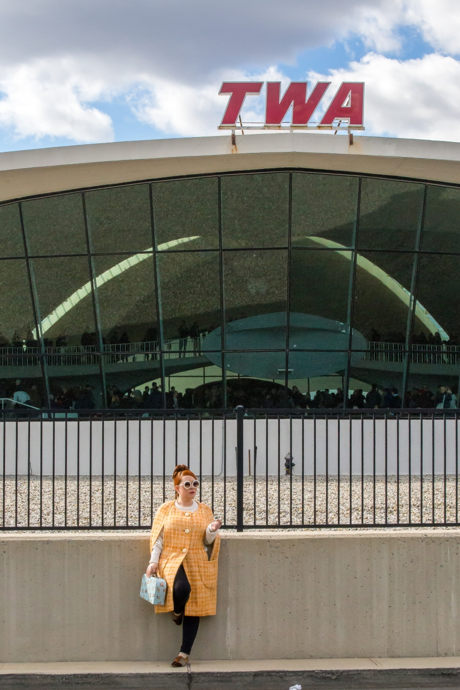 The idea of the time to come back is always there on First Class Belonging editorials, but what Nicole is narrating is the elegance of the modern era applied to today's life - a step up in the game of luxury. TWA terminal designed in 1962 by Aero Saarinen. JFK airport NY Vintage 1960s cape, Celine shoes,vintage cashmere sweater Vintage by Misty Photography: Proper Pix